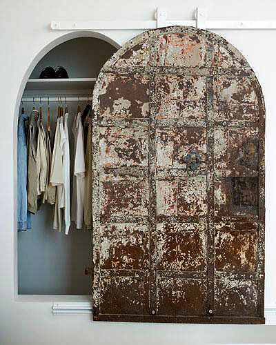 Love the rustic old world beauty of this closet door