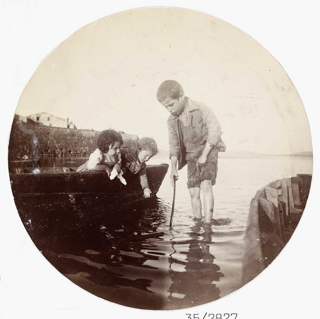 Boy-paddling-in-the-sea-about-1890.jpg